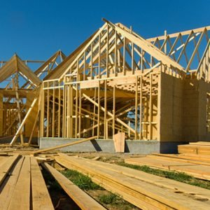 New home being built with wood plank, trusses and assorted supplies